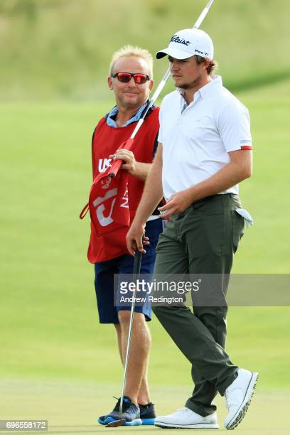 Eddie Pepperell of England waits to putt on the 12th green during the second round of the 2017 US Open at Erin Hills on June 16 2017 in Hartford...
