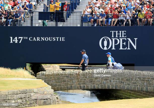 Eddie Pepperell of England walks across the bridge to the green on the 18th hole with his caddie Mick Doran during the final round of the 147th Open...