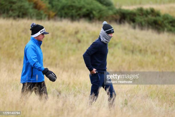 Eddie Pepperell of England walks down the 1st hole with Sean Crocker of the United States during Day Four of the Scottish Championship presented by...