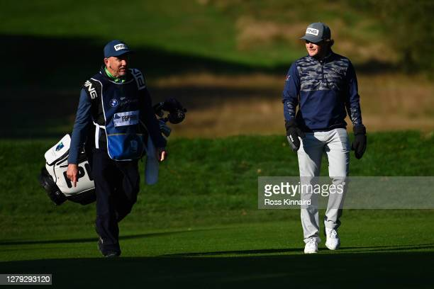 Eddie Pepperell of England walks with his caddie during Day 2 of the BMW PGA Championship at Wentworth Golf Club on October 09 2020 in Virginia Water...