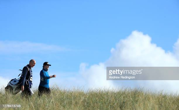Eddie Pepperell of England walks with his caddie Mick Doran on the 14th hole during the final round of the Aberdeen Standard Investments Scottish...