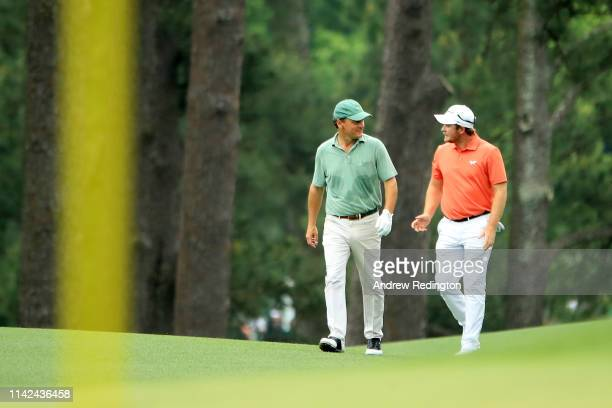 Eddie Pepperell of England walks with marker Jeff Knox on the eighth hole during the third round of the Masters at Augusta National Golf Club on...