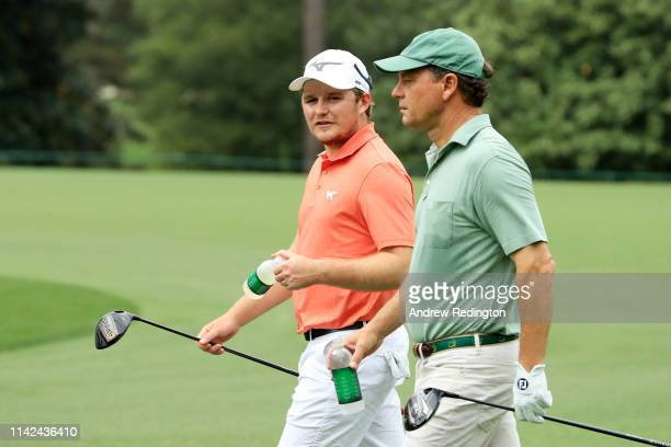 Eddie Pepperell of England walks with marker Jeff Knox on the ninth hole during the third round of the Masters at Augusta National Golf Club on April...