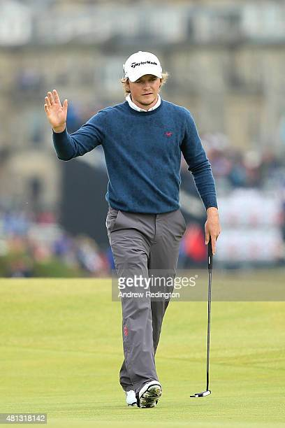 Eddie Pepperell of England waves to the crowd as he walks onto the 16th green during the third round of the 144th Open Championship at The Old Course...