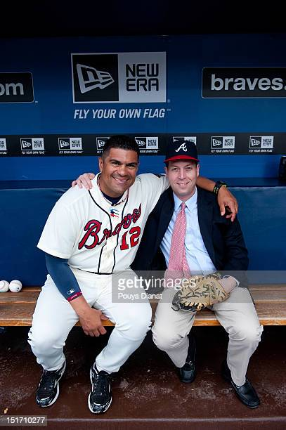 Eddie Peres bullpen coach of the Atlanta Braves poses with the grandson of Bill Bartholomay Bryan Duffy before the Delta Civil Rights Game against...