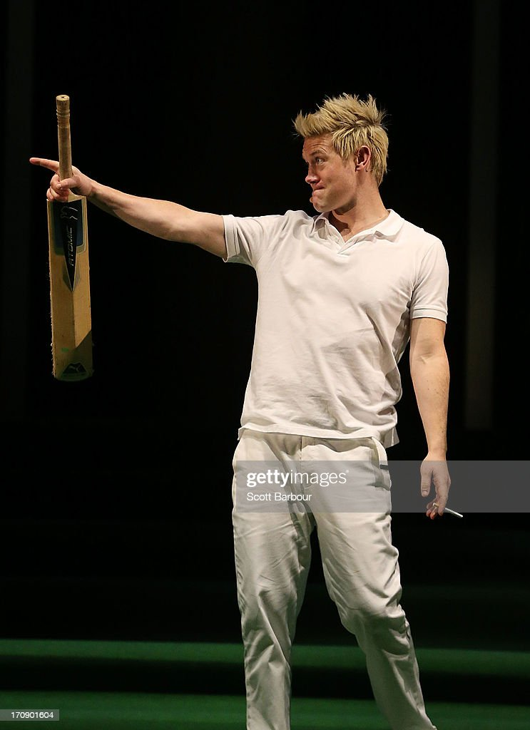 Eddie Perfect who plays Shane Warne holds a cricket bat and a cigarette as he sings during a 'Shane Warne The Musical' media call at the Arts Centre Melbourne on June 20, 2013 in Melbourne, Australia. Shane Warne The Musical is a musical comedy based on the life of Australian cricketer Shane Warne.