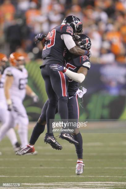 Eddie Pleasant and Andre Hal of the Houston Texans celebrate a defensive stop during their game against the Cincinnati Bengals at Paul Brown Stadium...