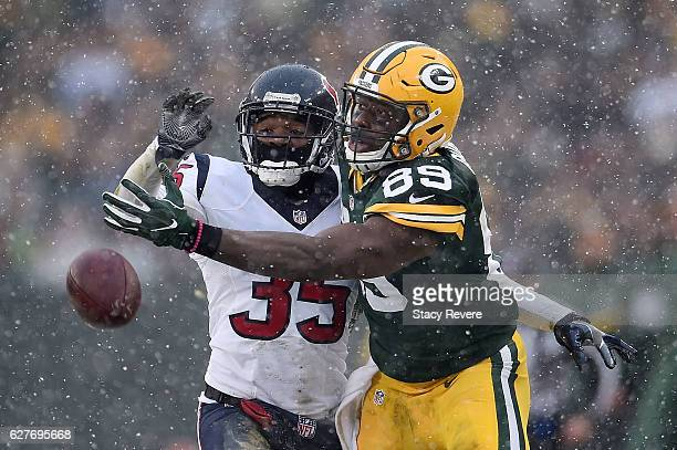 Eddie Pleasant of the Houston Texans defends a pass intended for Jared Cook of the Green Bay Packers during the second half of a game at Lambeau...