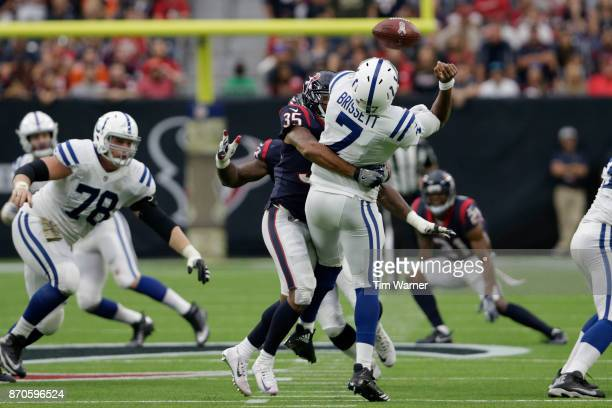Eddie Pleasant of the Houston Texans sacks Jacoby Brissett of the Indianapolis Colts forcing a fumble in the second quarter at NRG Stadium on...
