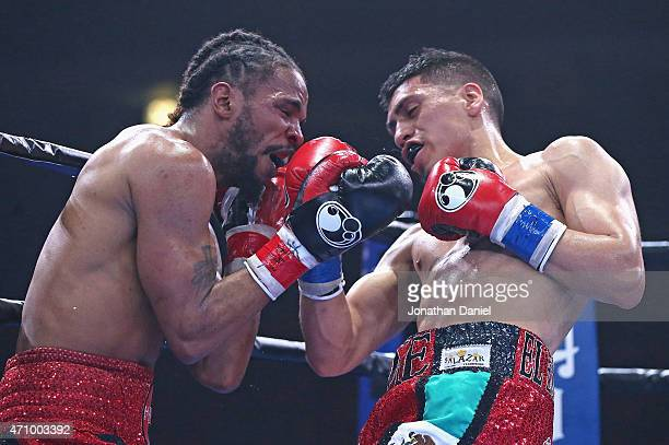 Eddie Ramirez hits Jerome Rodriguez during a junior welterweight fight at the UIC Pavilion on April 24, 2015 in Chicago, Illinois.