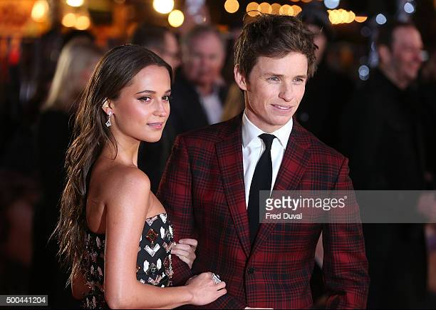 """Eddie Redmayne and Alicia Vikander attend the UK Premiere of """"The Danish Girl"""" at Odeon Leicester Square on December 8, 2015 in London, England."""