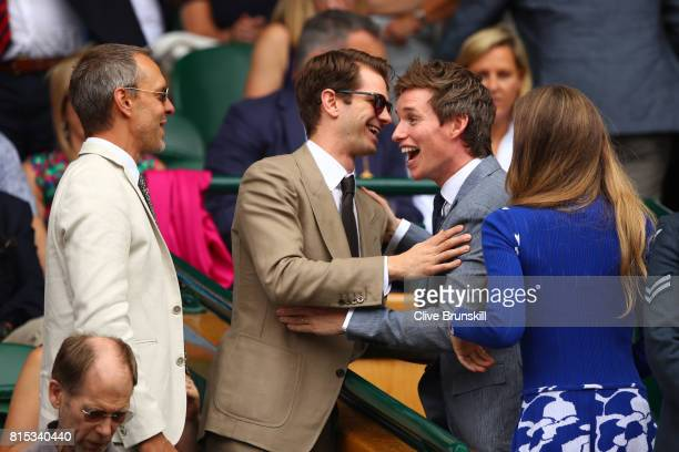 Eddie Redmayne and Andrew Garfield joke from the centre court royal box prior to the Gentlemen's Singles final between Roger Federer of Switzerland...