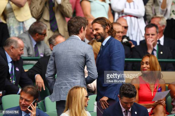 Eddie Redmayne and Bradley Cooper in discussion in the centre court royal box prior to the Gentlemen's Singles final between Roger Federer of...