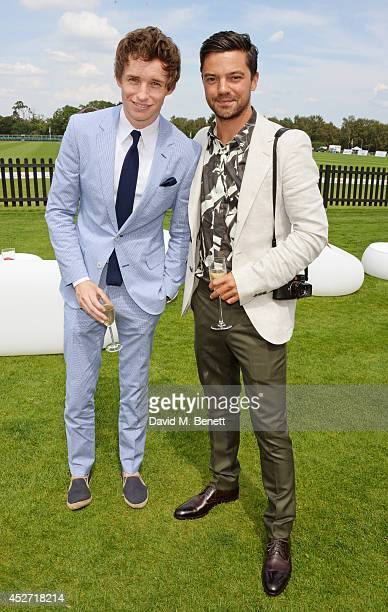 Eddie Redmayne and Dominic Cooper attend Audi International at Guards Polo Club near Windsor to support England as it faces Argentina for the...