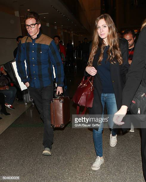 Eddie Redmayne and Hannah Bagshawe are seen at LAX on January 11 2016 in Los Angeles California