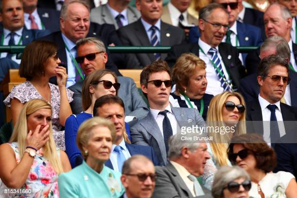 Eddie Redmayne and Hugh Grant look on from the centre court royal box prior to the Gentlemen's Singles final between Roger Federer of Switzerland and...