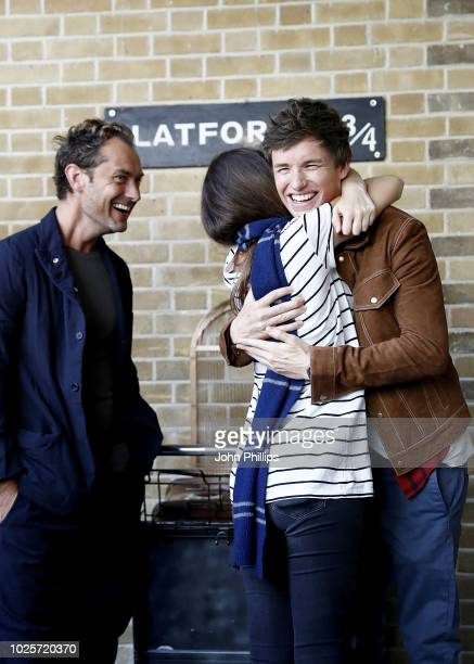 Eddie Redmayne and Jude Law stars of Fantastic Beasts The Crimes Of Grindelwald surprise fans at platform 9 3/4 during 'Back to Hogwarts' day...