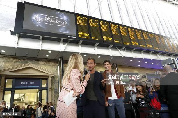 Eddie Redmayne and Jude Law stars of Fantastic Beasts The Crimes Of Grindelwald surprise fans at platform 9 3/4 during 'Back to Hogwarts' day...