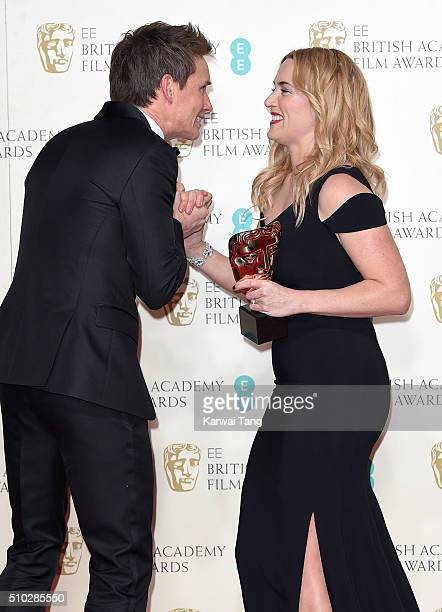 Eddie Redmayne and Kate Winslet with the award for Best Supporting Actress pose in the winners room at the EE British Academy Film Awards at The...