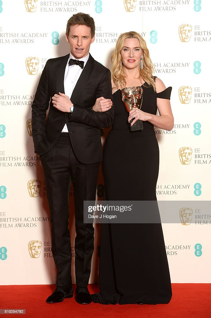 Eddie Redmayne (L) and Kate Winslet, with the award for Supporting Actress, pose in the winners room at the EE British Academy Film Awards at The Royal Opera House on February 14, 2016 in London, England.