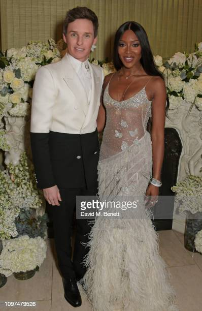 Eddie Redmayne and Naomi Campbell wearing Tiffany & Co. Attend the British Vogue and Tiffany & Co. Celebrate Fashion and Film Party at Annabel's on...