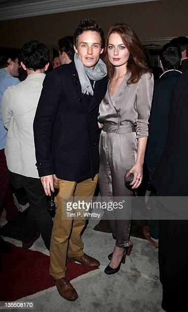 Eddie Redmayne and Rosalind Halstead attend a VIP Screening of The Artist at Charlotte Street Hotel on December 11 2011 in London England