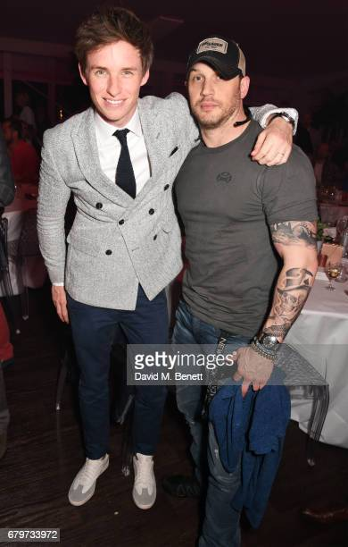 Eddie Redmayne and Tom Hardy attend the Audi Polo Challenge at Coworth Park on May 6 2017 in Ascot United Kingdom