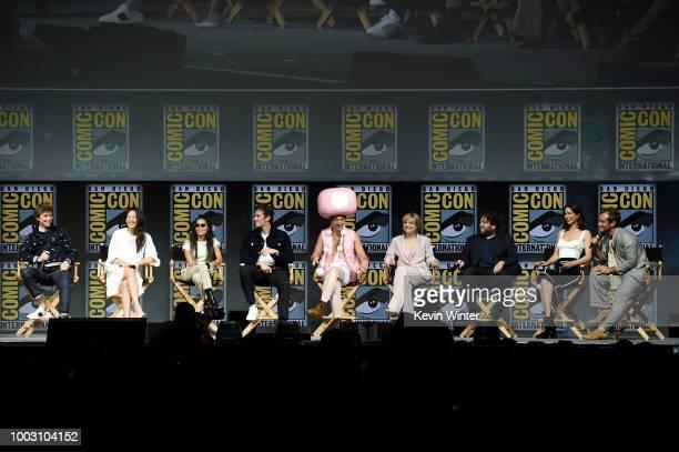 Eddie Redmayne Claudia Kim Zoe Kravitz Callum Turner Ezra Miller Alison Sudol Dan Fogler Katherine Waterson and Jude Law speak onstage at the Warner...