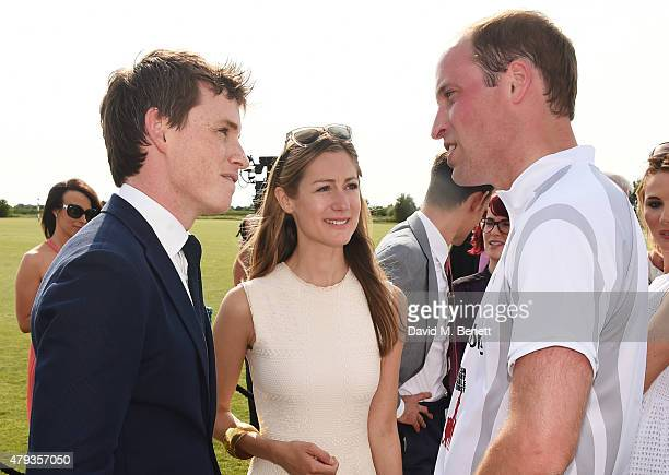 Eddie Redmayne Hannah Bagshawe and Prince William Duke of Cambridge attend the Audi Polo Challenge 2015 at Cambridge County Polo Club on July 3 2015...