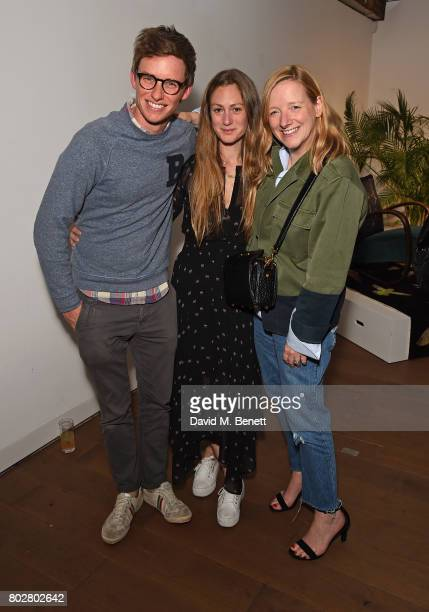 Eddie Redmayne, Hannah Bagshawe and Sarah Burton attend The Art Of Curating Fashion with Andrew Bolton presented by Sarabande: The Lee Alexander...