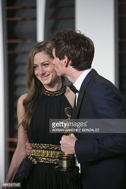 Eddie Redmayne holding his Oscar for best lead actor in The Theory of Everything and Hannah Bagshawe arrive to the 2015 Vanity Fair Oscar Party...