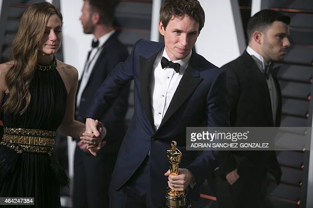 Eddie Redmayne, holding his Oscar for best lead actor in The Theory of Everything, and Hannah Bagshawe arrive to the 2015 Vanity Fair Oscar Party...