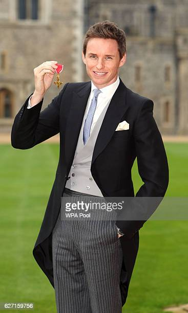 Eddie Redmayne poses after he was made an OBE by Queen Elizabeth II during an investiture ceremony at Windsor Castle on December 2 2016 in Windsor...