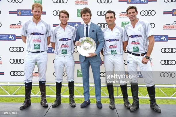 Eddie Redmayne poses with Prince Harry Duke of Sussex Charlie Hanbury Ollie Cudmore and Malcolm Borwick at the Audi Polo Challenge at Coworth Park...