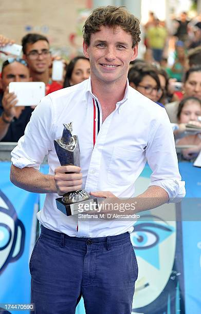 Eddie Redmayne poses with the Giffoni Award at 2013 Giffoni Film Festival blue carpet on July 26 2013 in Giffoni Valle Piana Italy