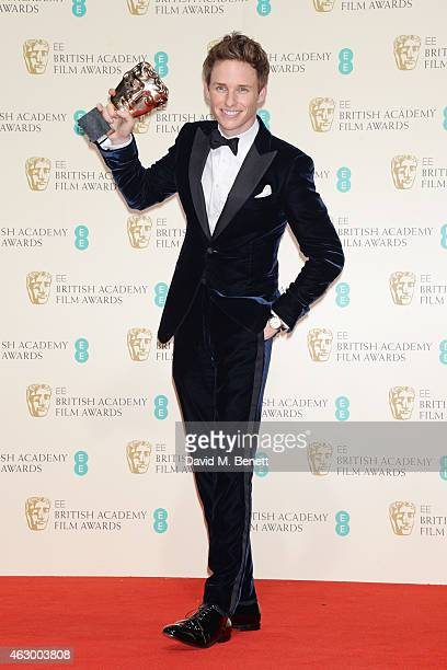 Eddie Redmayne winner of the Leading Actor award for The Theory Of Everything poses in the winners room at the EE British Academy Film Awards at The...