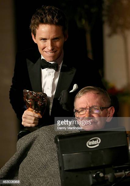 Eddie Redmayne with his winning BATFA and Stephen Hawking attend the after party for the EE British Academy Film Awards at The Grosvenor House Hotel...