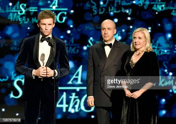 Eddie Redmayne Yuri Milner and Lucy Hawking speak onstage at the 2019 Breakthrough Prize at NASA Ames Research Center on November 4 2018 in Mountain...