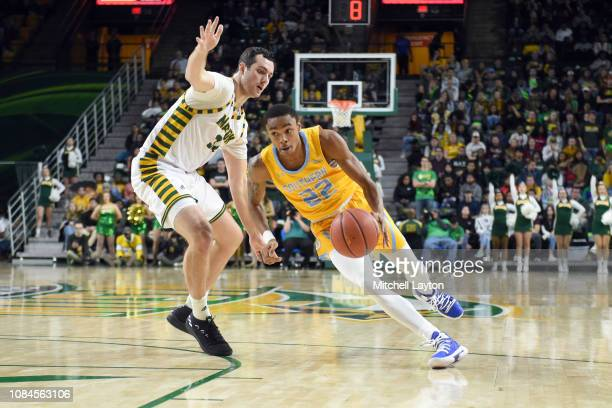 Eddie Reese of the Southern University Jaguars dribbles around Jarred Reuter of the George Mason Patriots during a college basketball game at the...