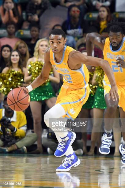 Eddie Reese of the Southern University Jaguars dribbles up court during a college basketball game against the George Mason Patriots at the Eagle Bank...