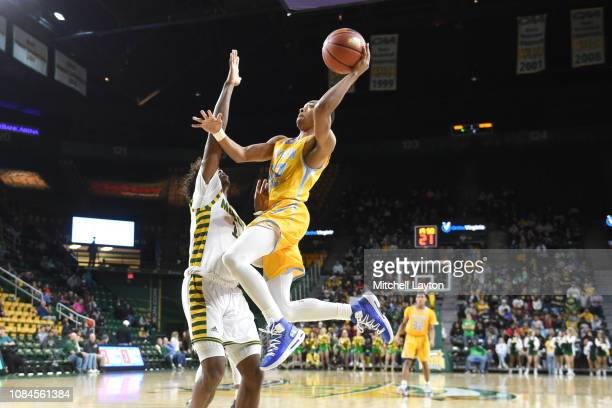 Eddie Reese of the Southern University Jaguars drives to the basket during a college basketball game against the George Mason Patriots at the Eagle...