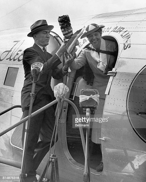 Eddie Rickenbacker and First Lady Eleanor Roosevelt christen an Eastern Airlines plane in Washington DC in 1937