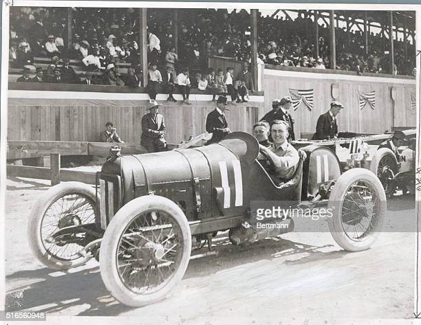 Eddie Rickenbacker WWI hero and eventual president of Eastern Airlines sitting in a race car