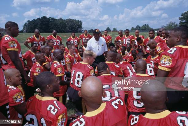 Eddie Robinson, Head Coach of the Grambling State University Tigers football team talks with his players during Media Day on 13th August 1997 at the...