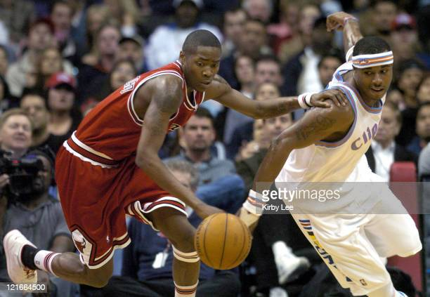 Eddie Robinson of the Chicago Bulls battles Quentin Richardson of the Los Angeles Clippers for a loose ball during the game between the Los Angeles...
