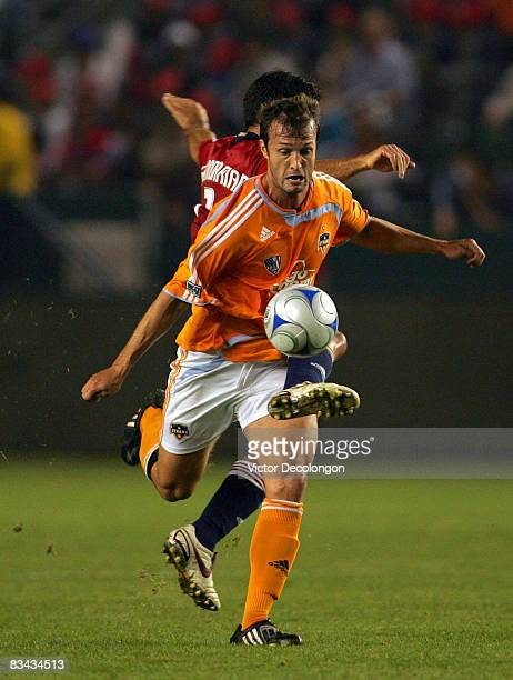 Eddie Robinson of the Houston Dynamo chests the ball down from Alecko Eskandarian of CD Chivas USA in the first half of their MLS match at The Home...