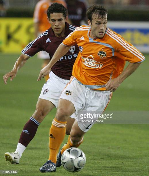 Eddie Robinson of the Houston Dynamo fights for possession against Omar Cummings of the Colorado Rapids on May 10, 2008 at Robertson Stadium in...