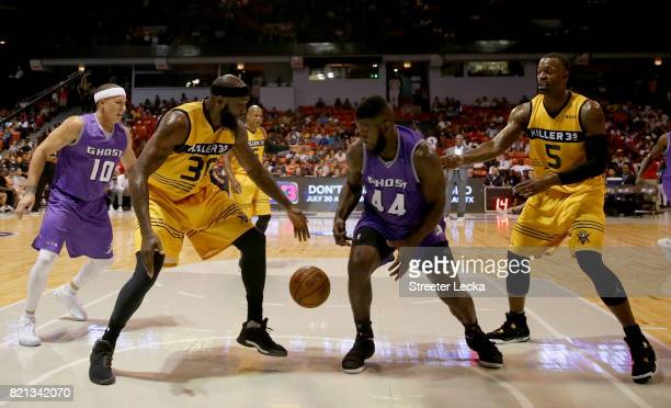 Eddie Robinson of the Killer 3s and Ivan Johnson of the Ghost Ballers battle for a loose ball during week five of the BIG3 three on three basketball...