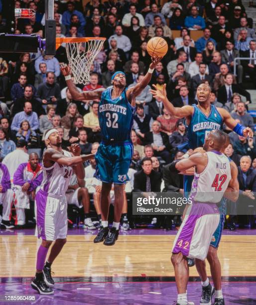 Eddie Robinson, Small Forward for the Charlotte Hornets and team mate Elden Campbell challenge for the ball over Kevin Willis and Morris Peterson of...