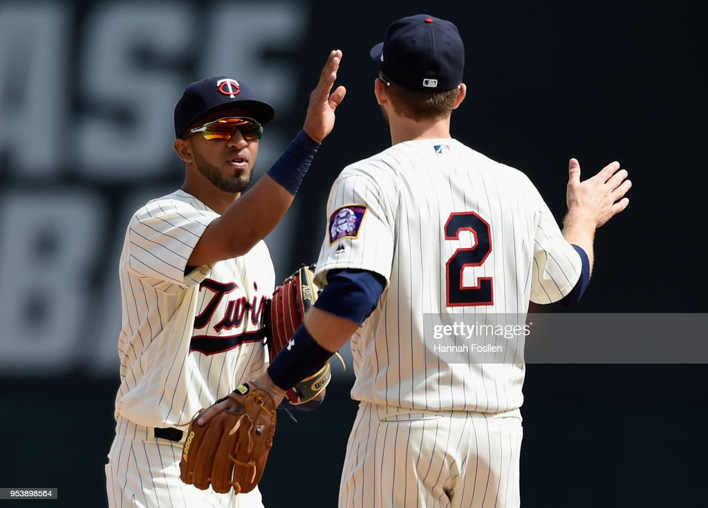 Eddie Rosario #20 and Brian Dozier #2 of the Minnesota Twins celebrate winning against the Toronto Blue Jays after the game on May 2, 2018 at Target Field in Minneapolis, Minnesota. The Twins defeated the Blue Jays 4-0.